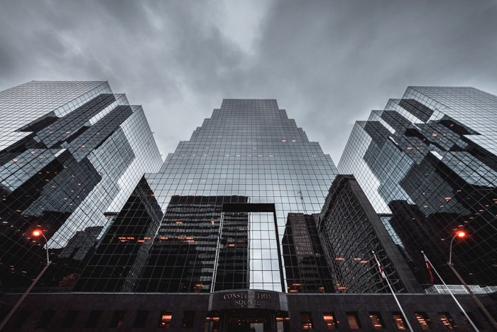 Buildings reflected in mirrored skyscrapers