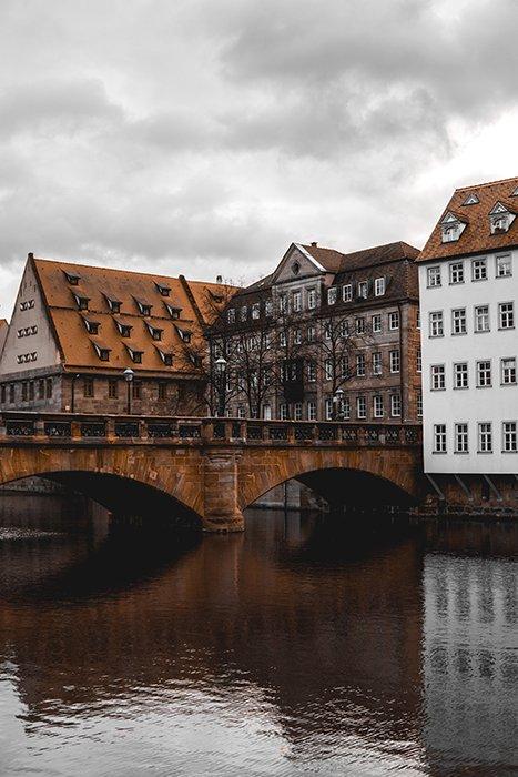 A pretty stone bridge over a river in Nuremberg, Germany