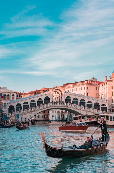 A beautiful shot of a gondola in a canal in venice - best cities to visit in europe