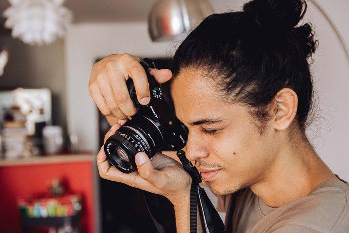 A photographer shooting through a Sony dslr camera