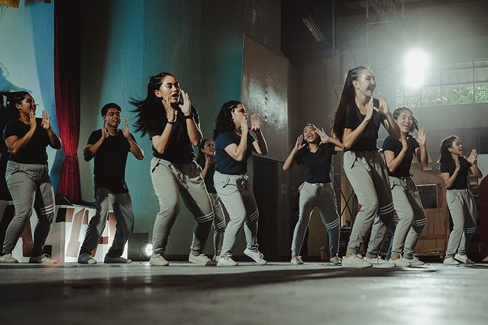 Multiple dancers on stage during a performance - dance event photography