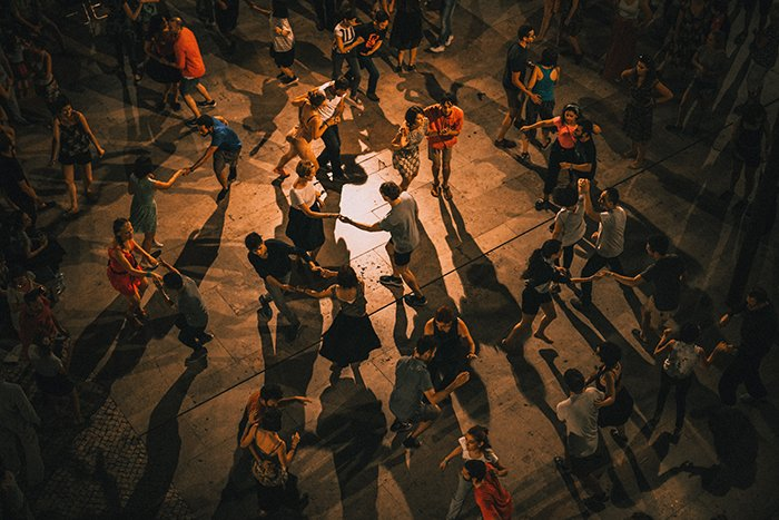 A high angle shot of people dancing indoors