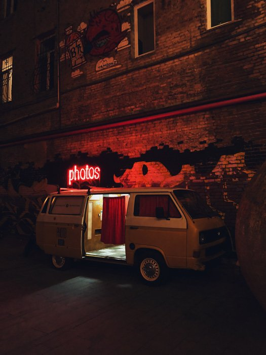 A photo booth set up in a van at night