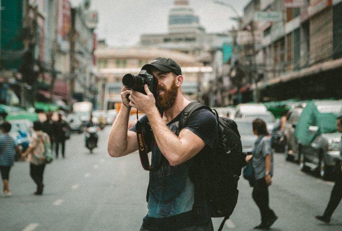 A photographer shooting street photographer