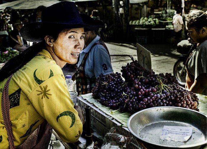 A street portrait of a market vendor