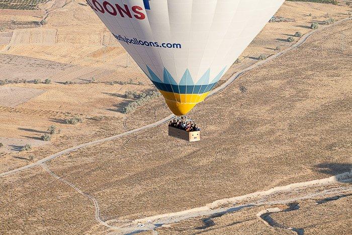 A hot air balloon over a flat grassy landscape