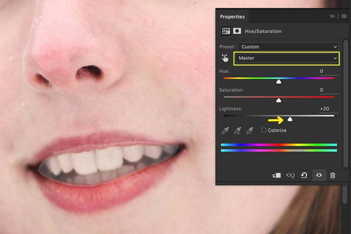 A screenshot showing how to brighten teeth using hue saturation adjustment in Photoshop