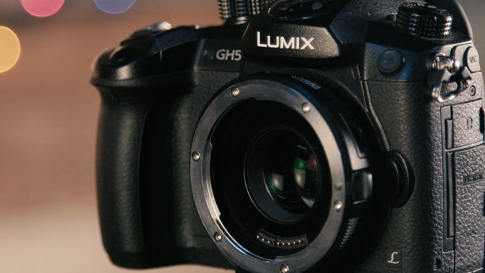 A Lumix DSLR camera fitted with a lens mount