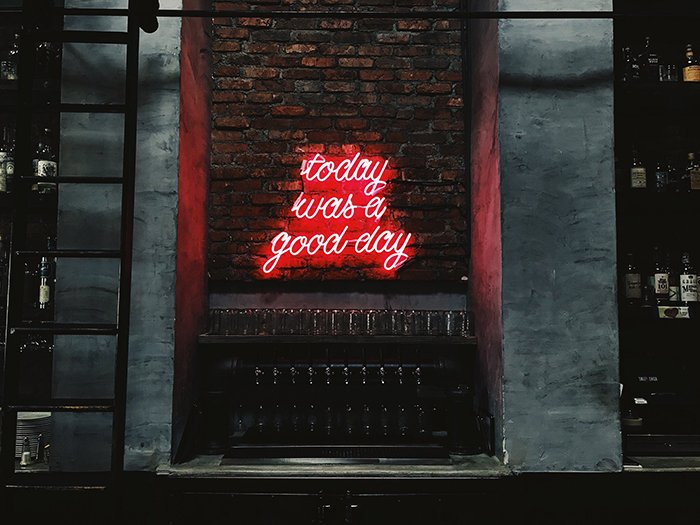 A photo of a red neon sign reading 'today was a good day' - neon signs photography