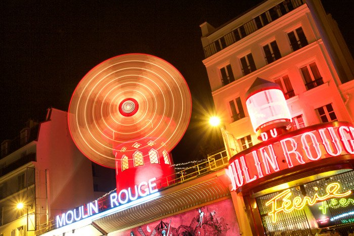 The Moulin Rouge at night using a long exposure.