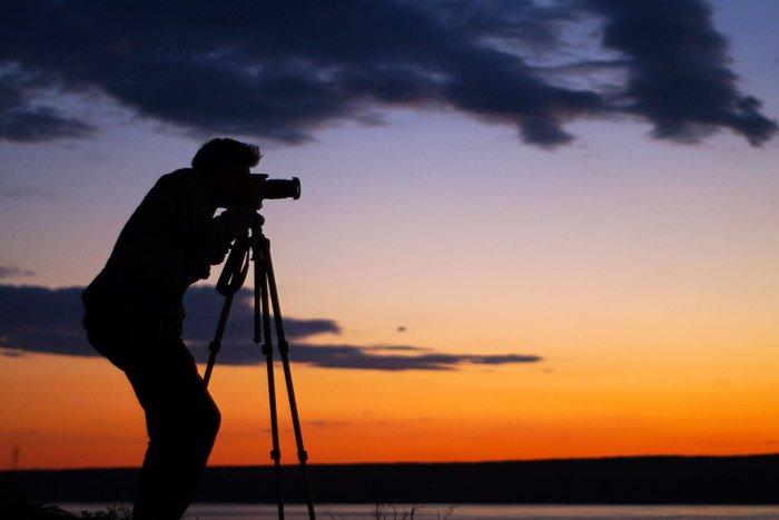 A photographer shooting a sunset