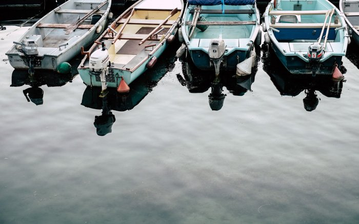 Four boats parked in a harbour
