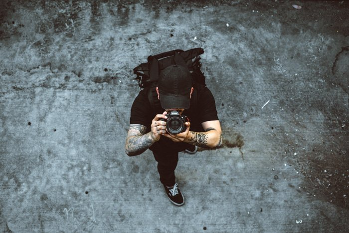 An overhead shot of a photographer shooting with a DSLR