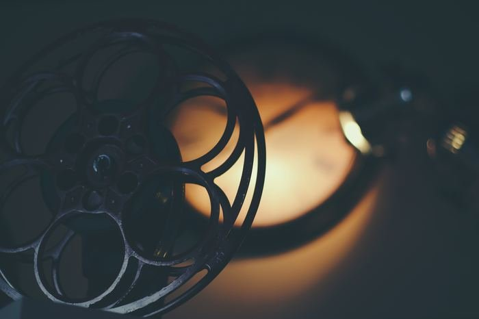 An atmospheric photo of a film reel - best photography movies