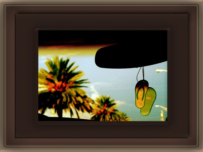 A photo looking out the front window of a car, with a PNG Photoshop frame