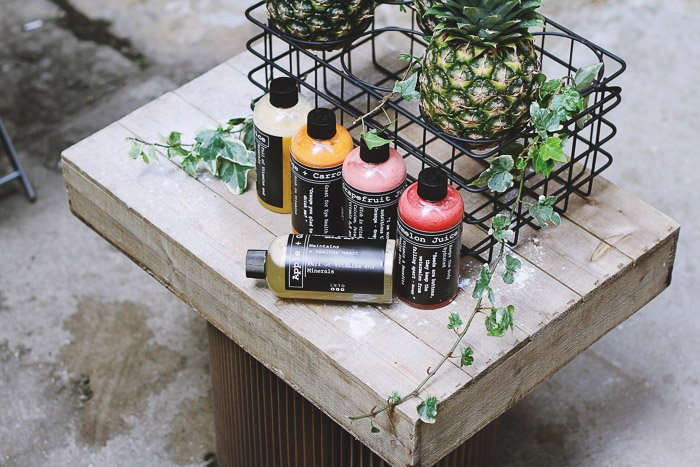 A product photography shot of a cosmetics on a rustic wooden table