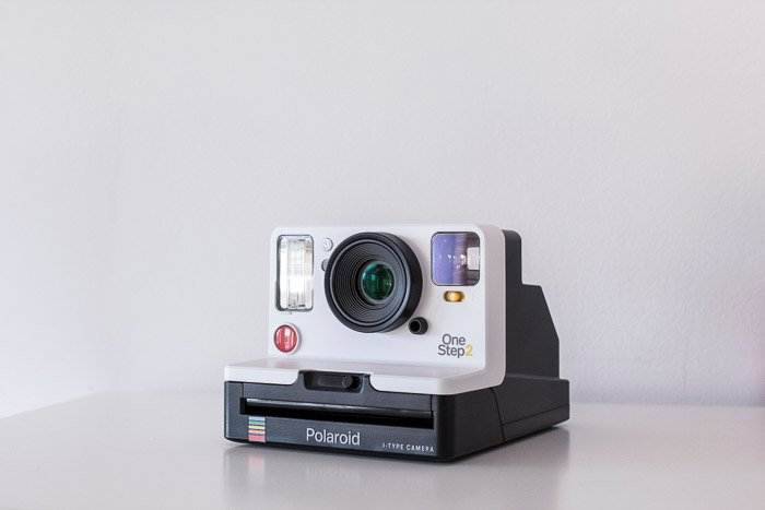 A product photography shot of a polaroid camera on white background