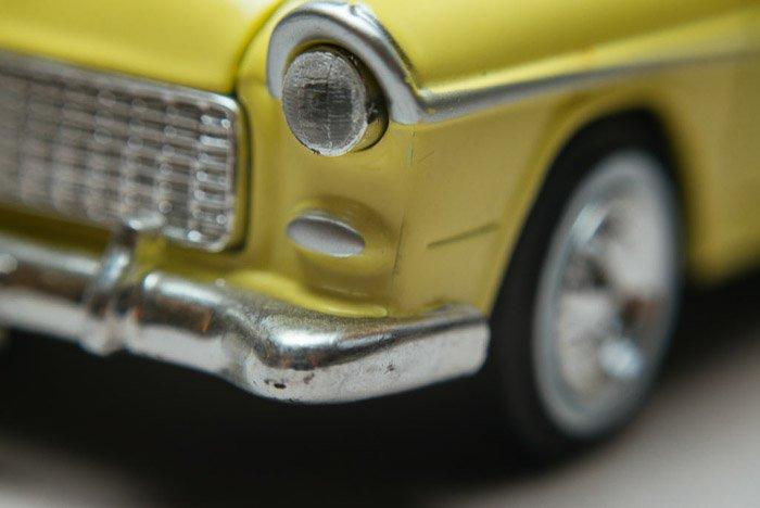 A macro photo of a green car shot using lens reversing rings