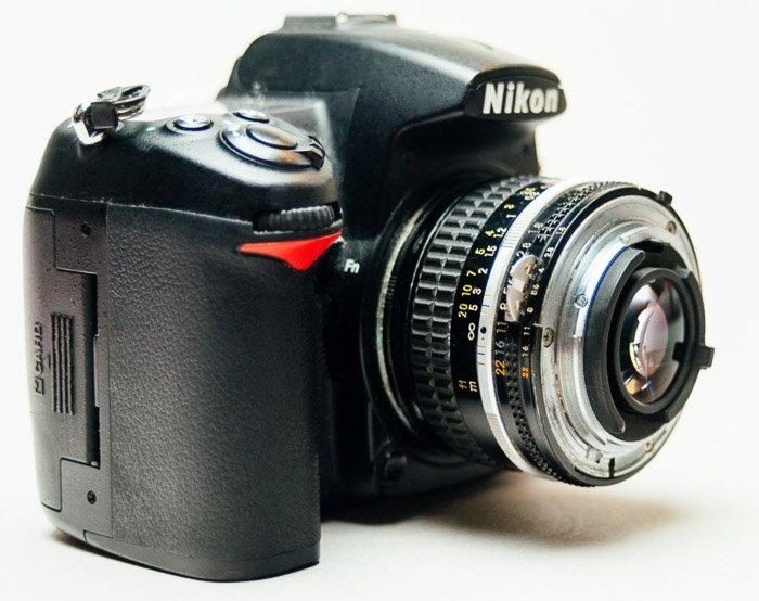 A Nikon dslr camera fitted with reversing rings for macro photography