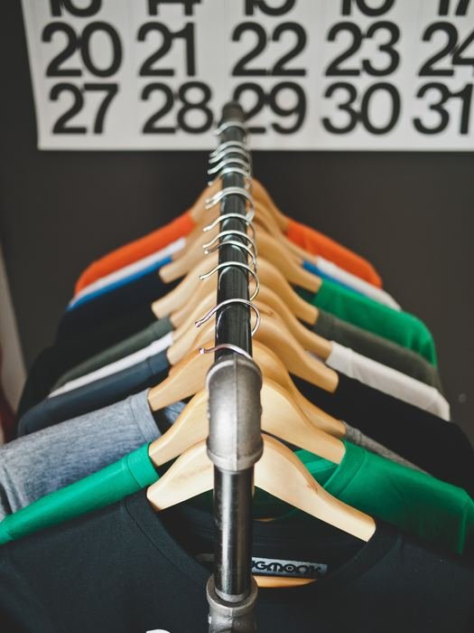 An overhead shot of cool t-shirts for photographers hanging on a rack