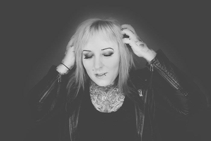 Artistic black and white photo of a tattooed female model