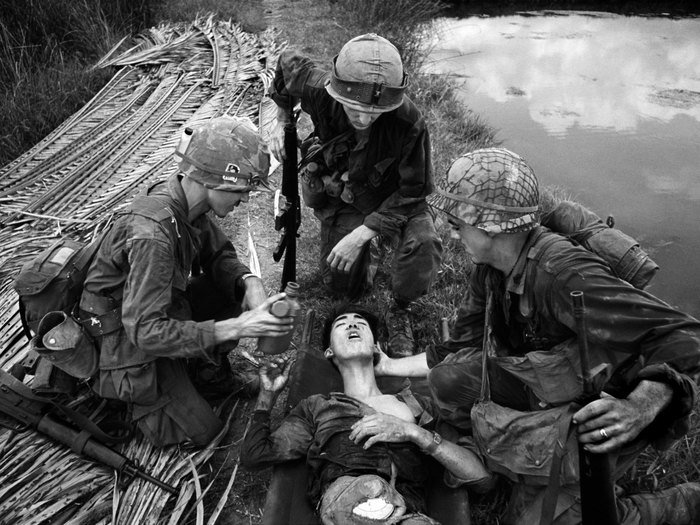 A black and white war photography shot by Philip Jones-Griffiths