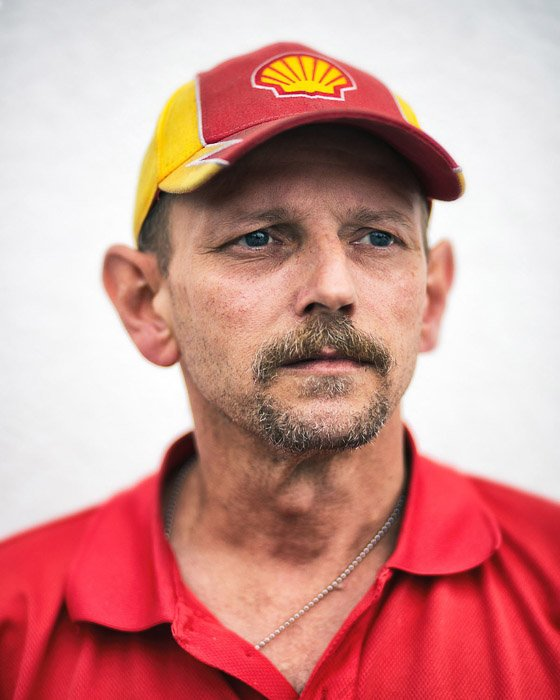 A documentary portrait of a man in a shell uniform