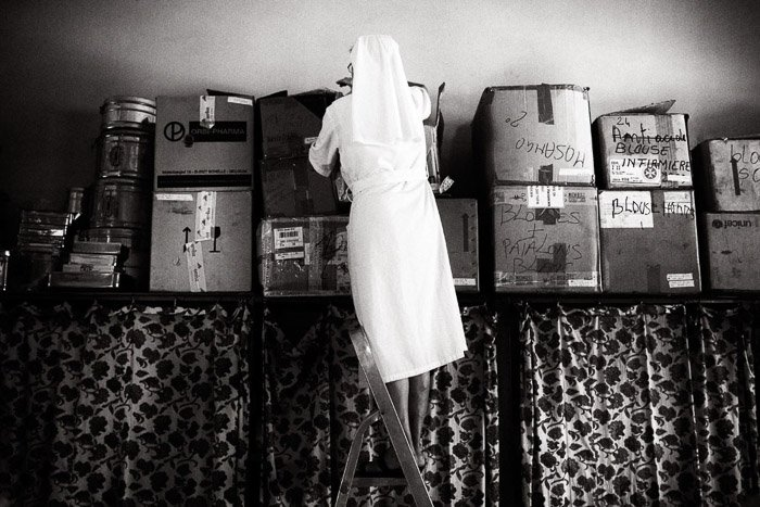 A black and white photo of a Catholic nun in the DRC. Photojournalism vs documentary photography