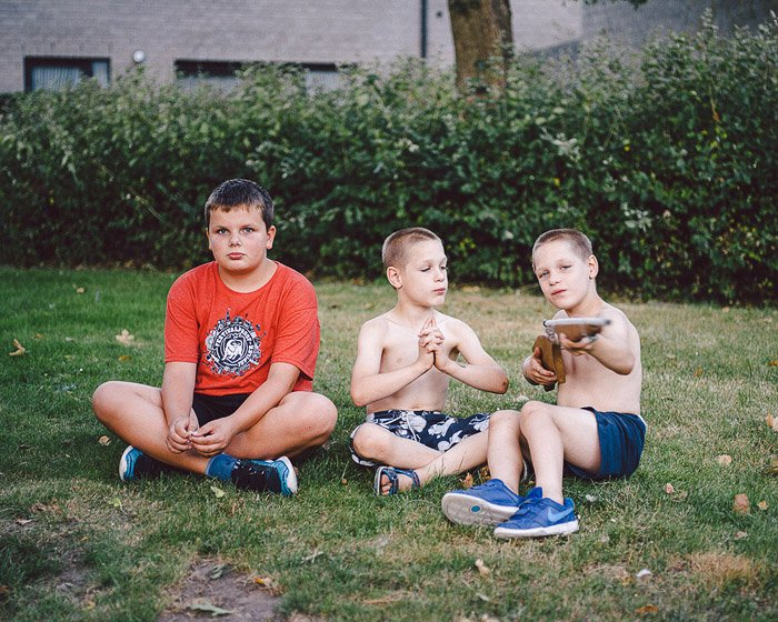 A portrait of three boys. From 'Grey Summer Garden'. Photojournalism vs documentary photography
