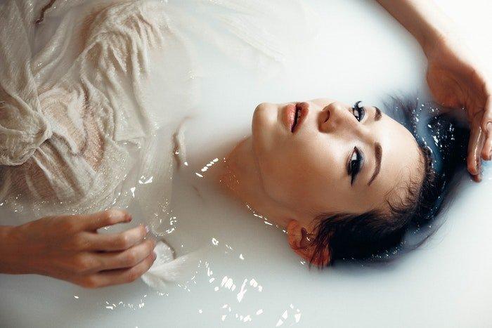 Portrait of a woman in a milk bath