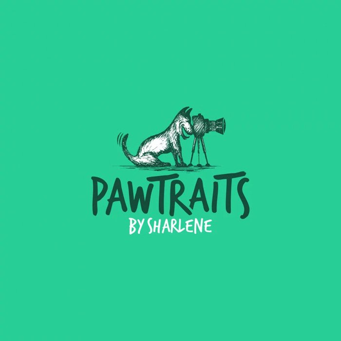 Pawtraits photography logo of a dog sitting behind the camera