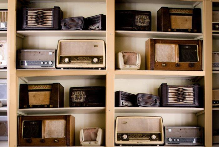 A shelving unite displaying many vintage radio sets - bad types of stock photos