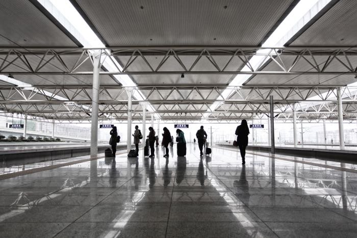 People waiting for a train at a station platform