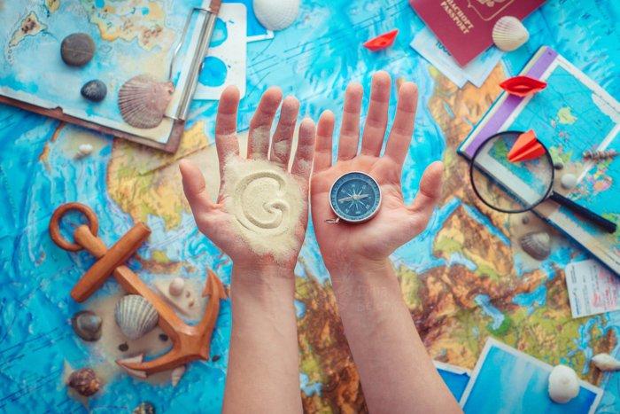 A creative travel themed still life flat lay