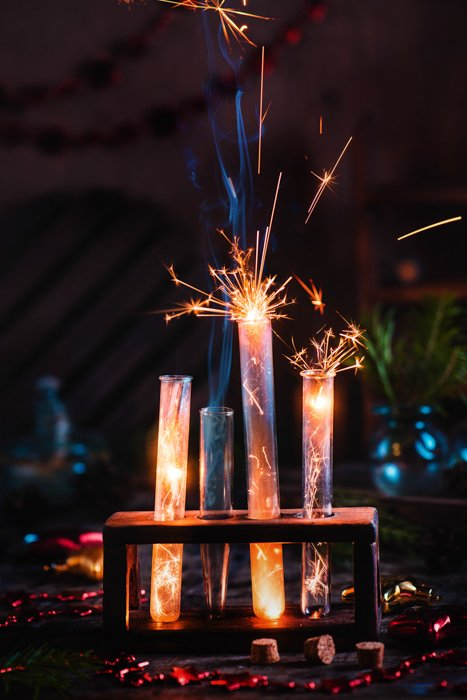 A magic themed still life composition featuring sparklers and test tubes