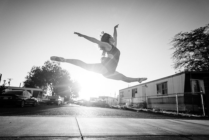 A beautiful ballet photography shot of a female dancer posing outdoors