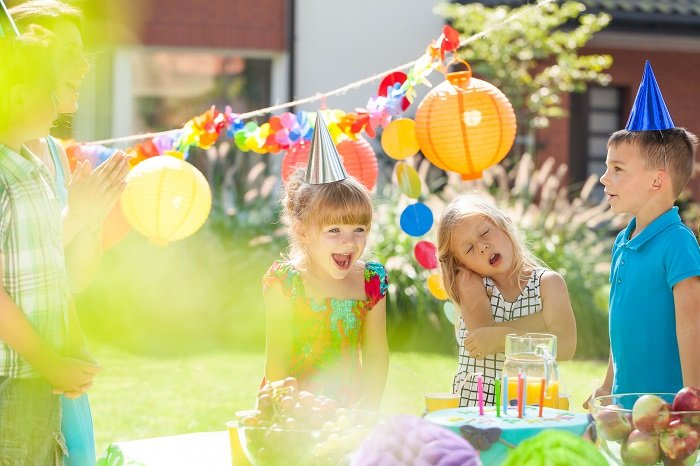 Happy children with party hats having fun on a birthday party