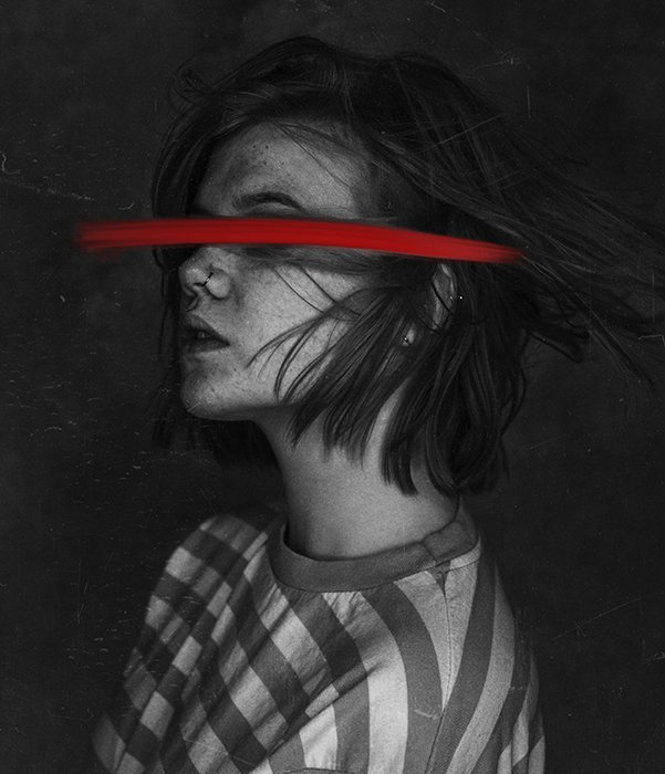 A surreal monotone portrait of a female model featuring a painted red streak over her eyes - conceptual photography ideas