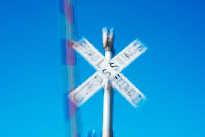 A blurred photo of railway crossing sign - zoom burst photos