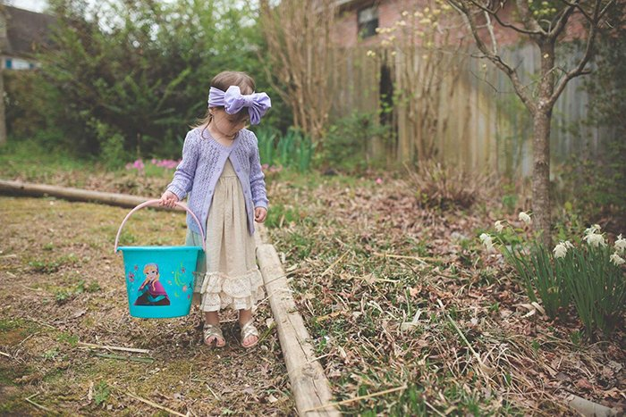A sweet Easter portrait of a little girl on an Easter egg hunt