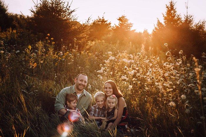 Family portrait in a backlit scene.