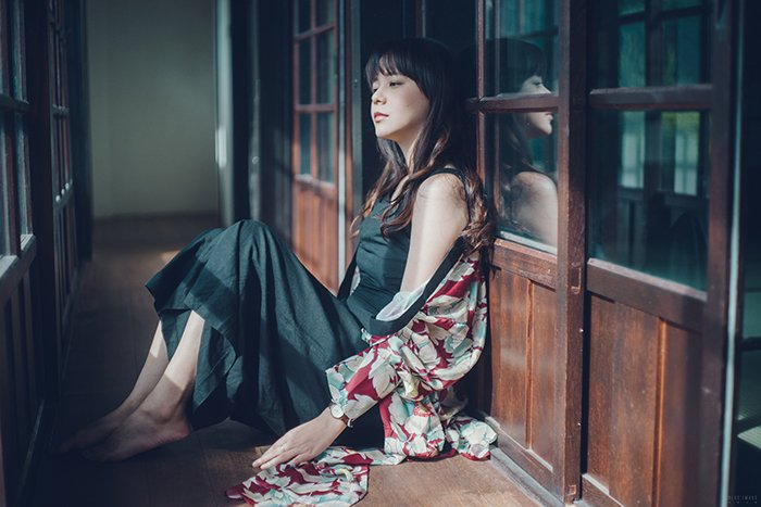 Atmospheric fine art photo of a female model sitting on a floor