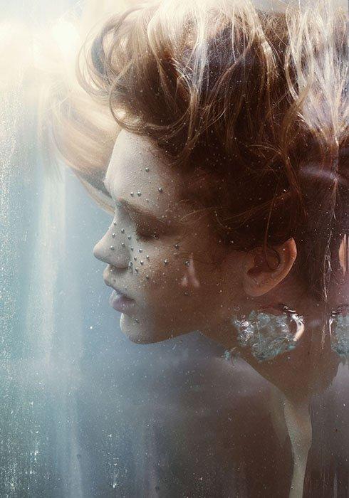 Dreamy underwater portrait of a female model