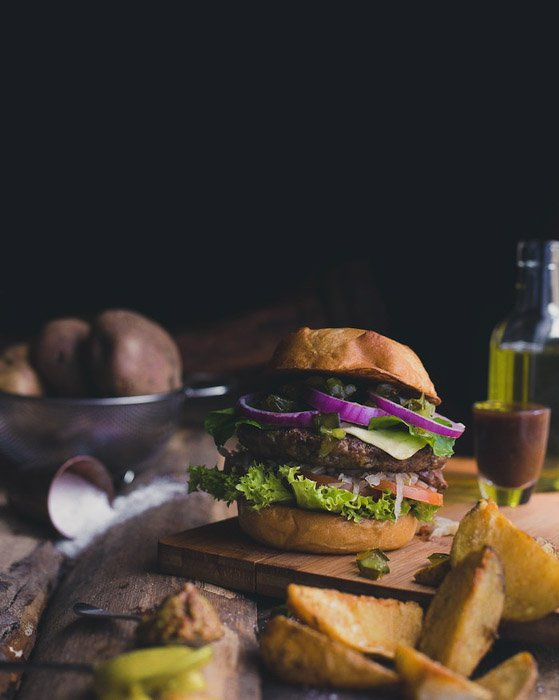 Dark and moody food portrait of a hamburger - food photography examples