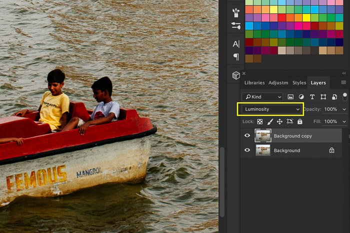 A screenshot showing how to sharpen an image in Photoshop using a photo of a small boat in a lake