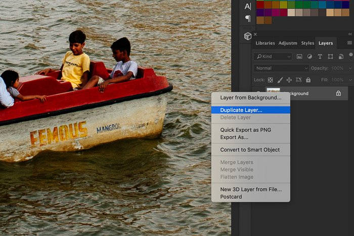 A screenshot showing how to sharpen images in Photoshop using a photo of a small boat in a lake