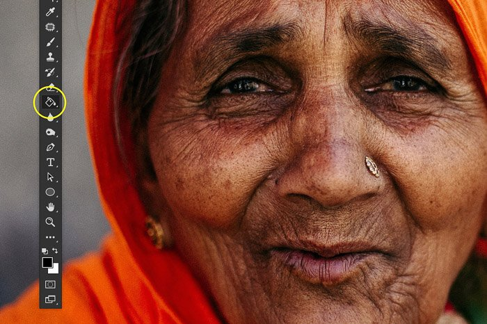 A screenshot showing image sharpening in Photoshop using a portrait of an Indian woman