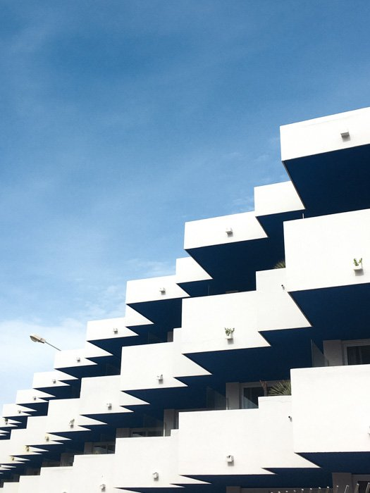 A multilayered apartment building under a blue sky - different file formats