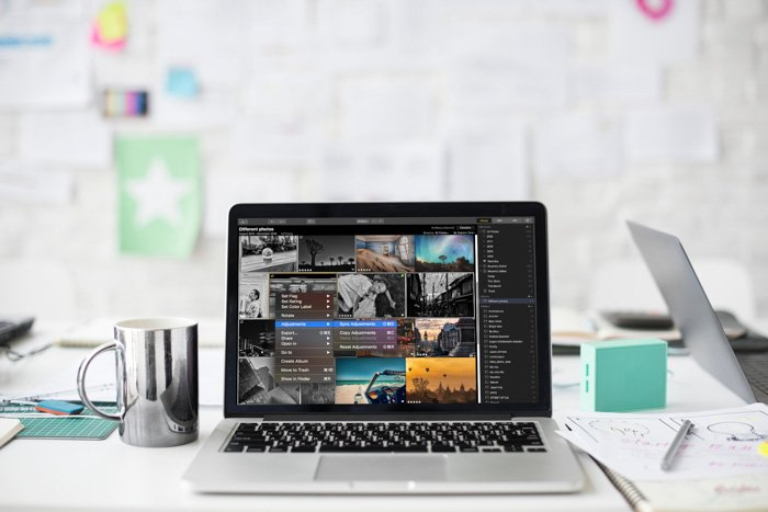 A laptop on an office desk open on a photo editing screen - Skylum Luminar review