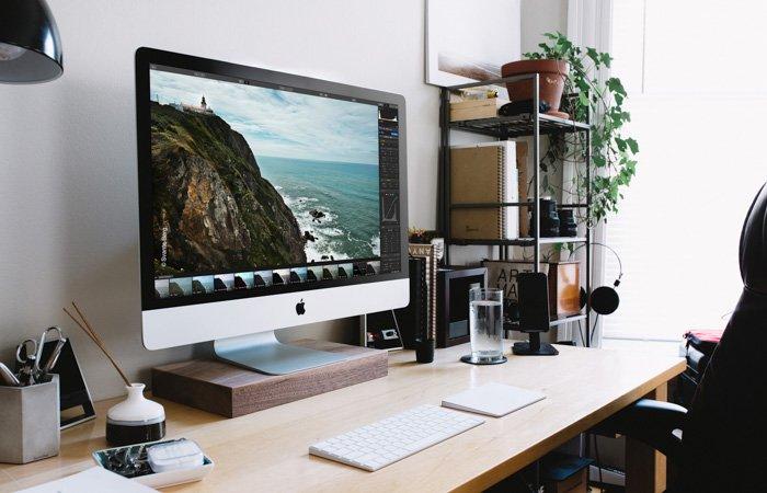 A computer on an office desk open on a photo editing screen - Skylum Luminar review